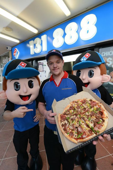 RAISING DOUGH: Ipswich Dominos store manager Jamee Winnington-Martin is raising funds for recent house fire victims.