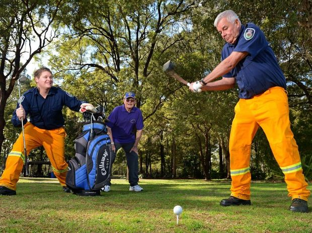 NSW rural fire service volunteer firemen Andrew Robinson and Trevor Bird are fired up for the golf day with John Harden of Lions.