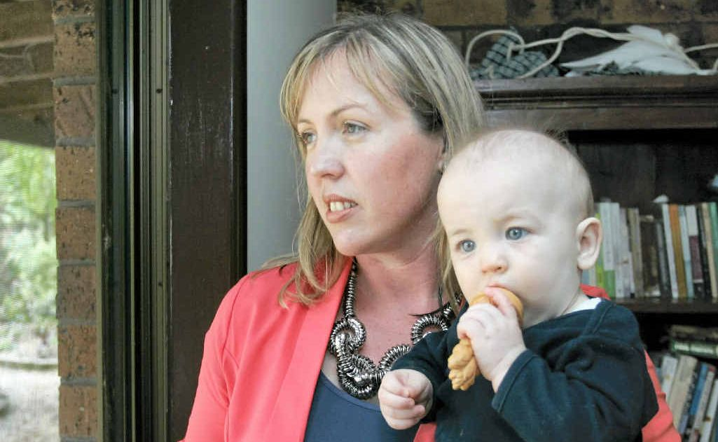 Victoria Murray, with her youngest child Thomas, says mining families are concerned for the future.