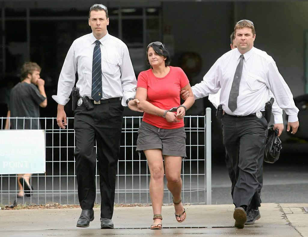 A woman charged with a Gladstone murder is taken into custody by police at the Rockhampton watchhouse.