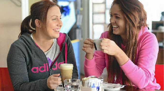 Mikaela Pryor and Emily Morris enjoy a coffee at Rocksalt.