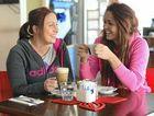 Mikaela Pryor and Emily Morris enjoy a coffee at Rocksalt.
