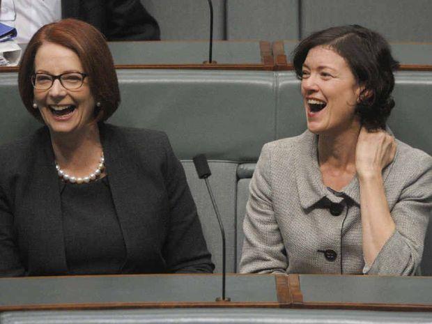 Former Prime Minister Julia Gillard (left) and Labor MP Kirsten Livermore share a laugh together in June 2013.