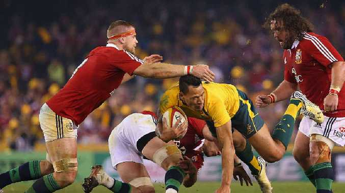 DANGER MAN: The Lions gang up on the Wallabies' Israel Folau at Melbourne's Etihad Stadium last night.