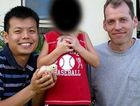 Double lives: Mark Newton, right, with Peter Truong and their son outside their Cairns home.