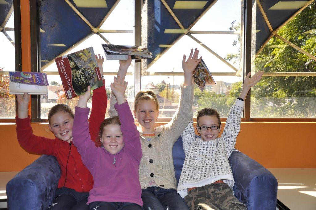 Sarah-Beth Geoghegan, 10, Ashlee Geoghegan, 8, Brittany Geoghegan, 13, and Lachlan Rub, 10, having some holiday fun at the library.