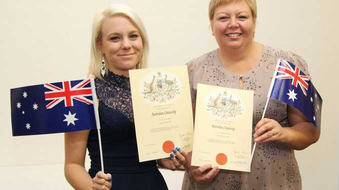 NEW FLAG: Katie White and her mum Julie White celebrate becoming Australian citizens at Esk.