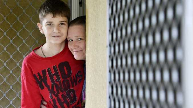 Michael Boggan, 15, photographed at home with his mother Rebecca.