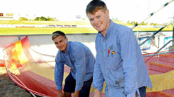 Eddy Nixon and Peter McCarthy help prepare Virgin Australia Stadium for this Sunday's NRL game between the Bulldogs and the Knights.
