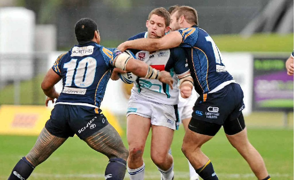 Ryan Hansen is stopped by the Devils' defence at Stockland Park.