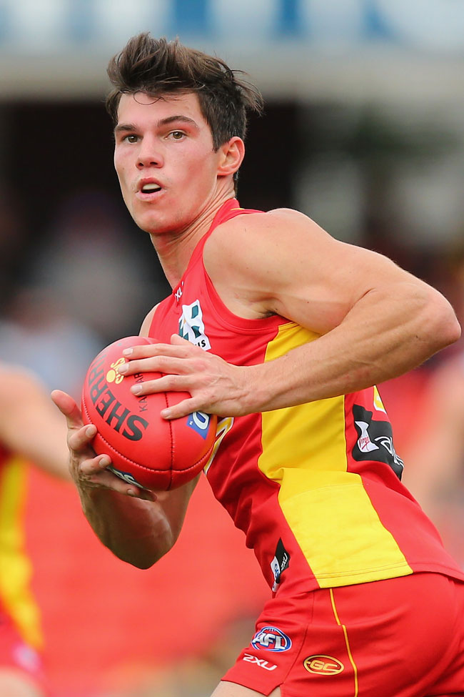 Jaeger O'Meara of the Suns runs the ball during the round 14 AFL match between the Gold Coast Suns and the Adelaide Crows