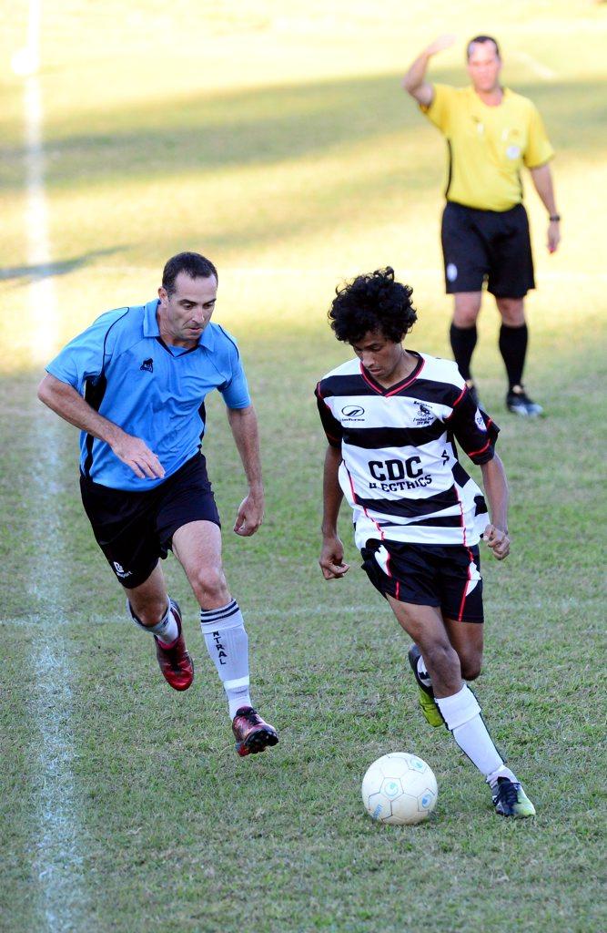 David Slack vs Zhayd Harbin. Nerimbera Vs Central. Soccer / Football Queensland at Pilbeam Park. Photo Sharyn O'Neill / The Morning Bulletin