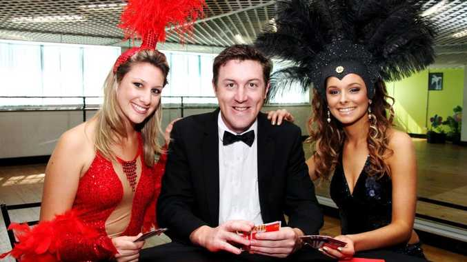 CASINO ROYALE: Performers Katherine Brown, Dan Thomas and Bree Johnstone get into character in preparation for the Umoja Orphanage Kenya's 2nd Annual Charity Gala Dinner Dance. Photo: Zach Hogg / NewsMail