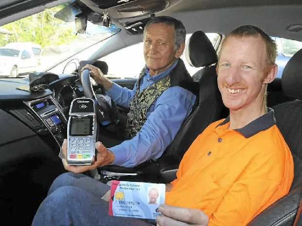 Taxi driver Ian Sims with regular passenger of the Taxi Subsidy Scheme Craig Sinn.