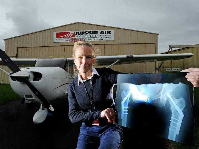 Commercial pilot Sarah Biddle of Teven whose determination has overcome a disability with metal plates and screws inserted into her hips.