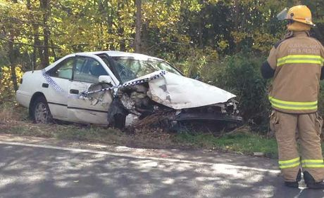 This car crashed into a concrete barrier while travelling down the Toowoomba Range. It is one of two crashes on the Range this afternoon.