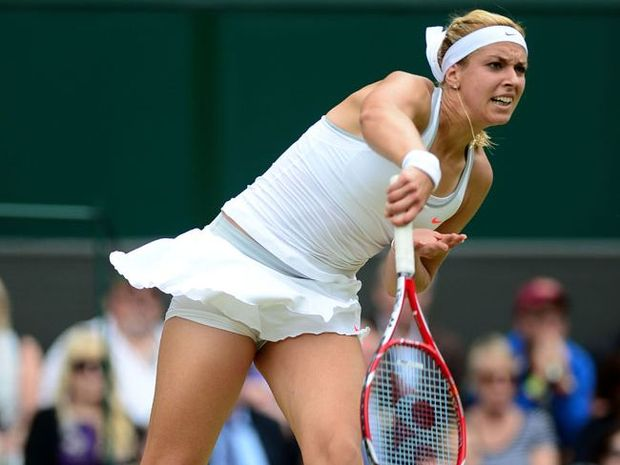 Sabine Lisicki of Germany serves during her Ladies' Singles fourth round match against Serena Williams of United States of America on day seven of the Wimbledon Lawn Tennis Championships.