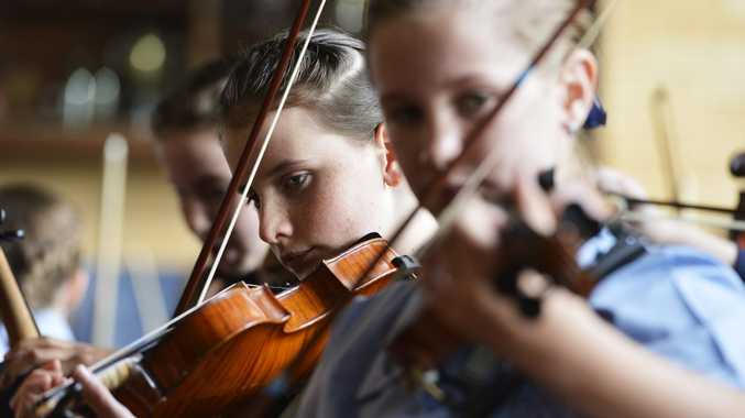 ON THE COUNT OF FOUR: Student musicians from Ipswich Girls' Grammar School will take part in a world record attempt at Brisbane's Suncorp Stadium on July 13 to be part of the world's biggest orchestra.