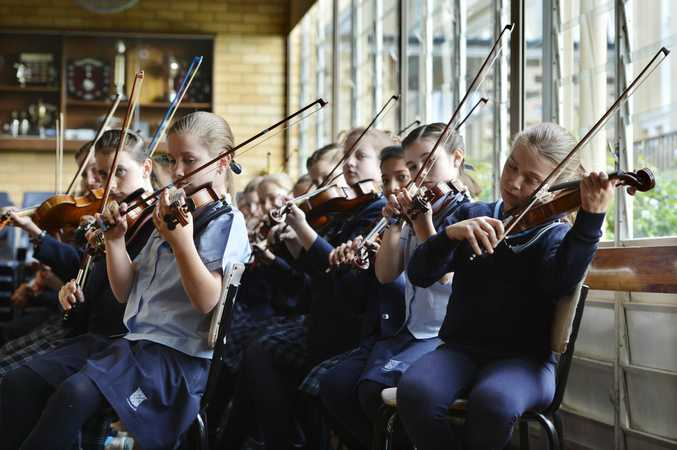 Student musicians from Ipswich Girls' Grammar School are taking part in a world record attempt in Brisbane to be part of the world's biggest orchestra.