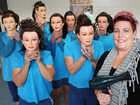 WITH STYLE: TAFE hairdressing teacher Rachael celebrates with prisoners at the Brisbane Women's Correctional Centre's completion of a Certificate II in Hairdressing.