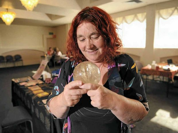 Psychic Cassandra Eason gazes into her crystal ball at the Australian Psychic Expo, which is on until Sunday at the Rocky Glen Hotel in Gladstone.