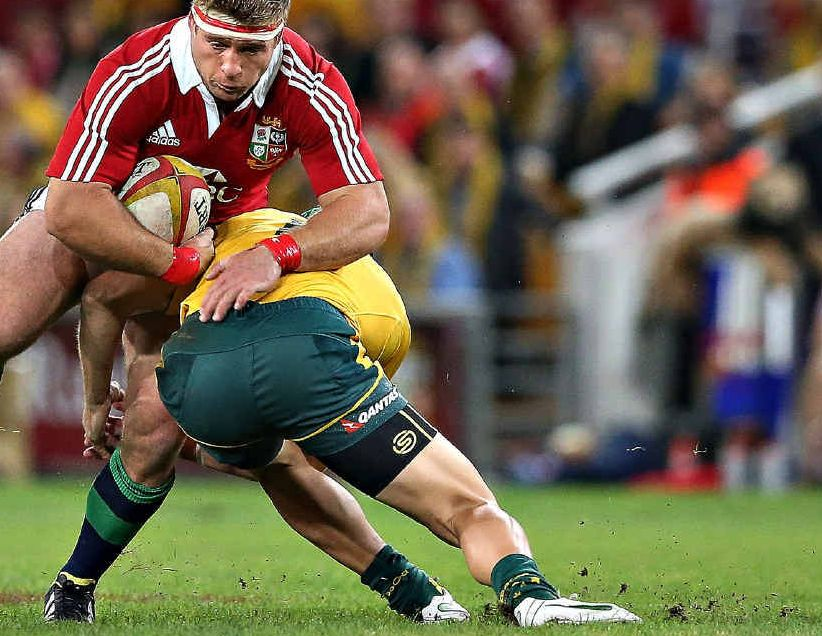 British and Irish Lions hooker Tom Youngs is stopped in his tracks by Australia's Berrick Barnes at Brisbane's Suncorp Stadium on June 22.
