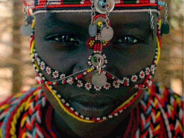 A young Samburu woman from Umoja women's village in the woman's only communal area of the village.