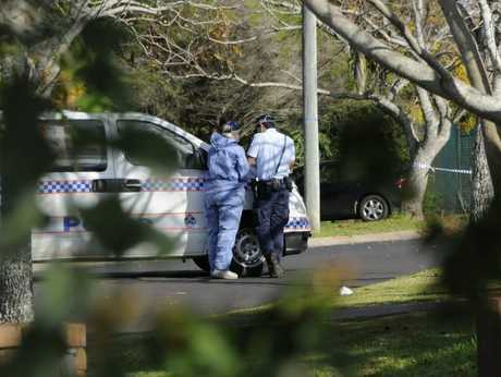 Police at the scene of the Wilsonton Heights murder.