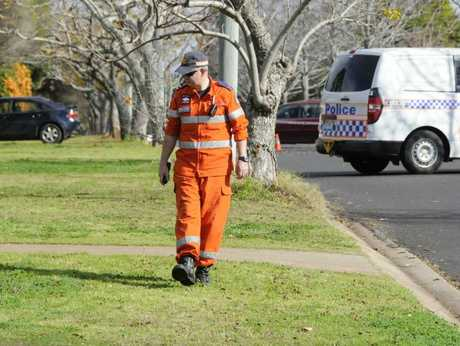 A State Emergency Service volunteer search suburban streets for clues to an alleged murder in Wilsonton Heights.