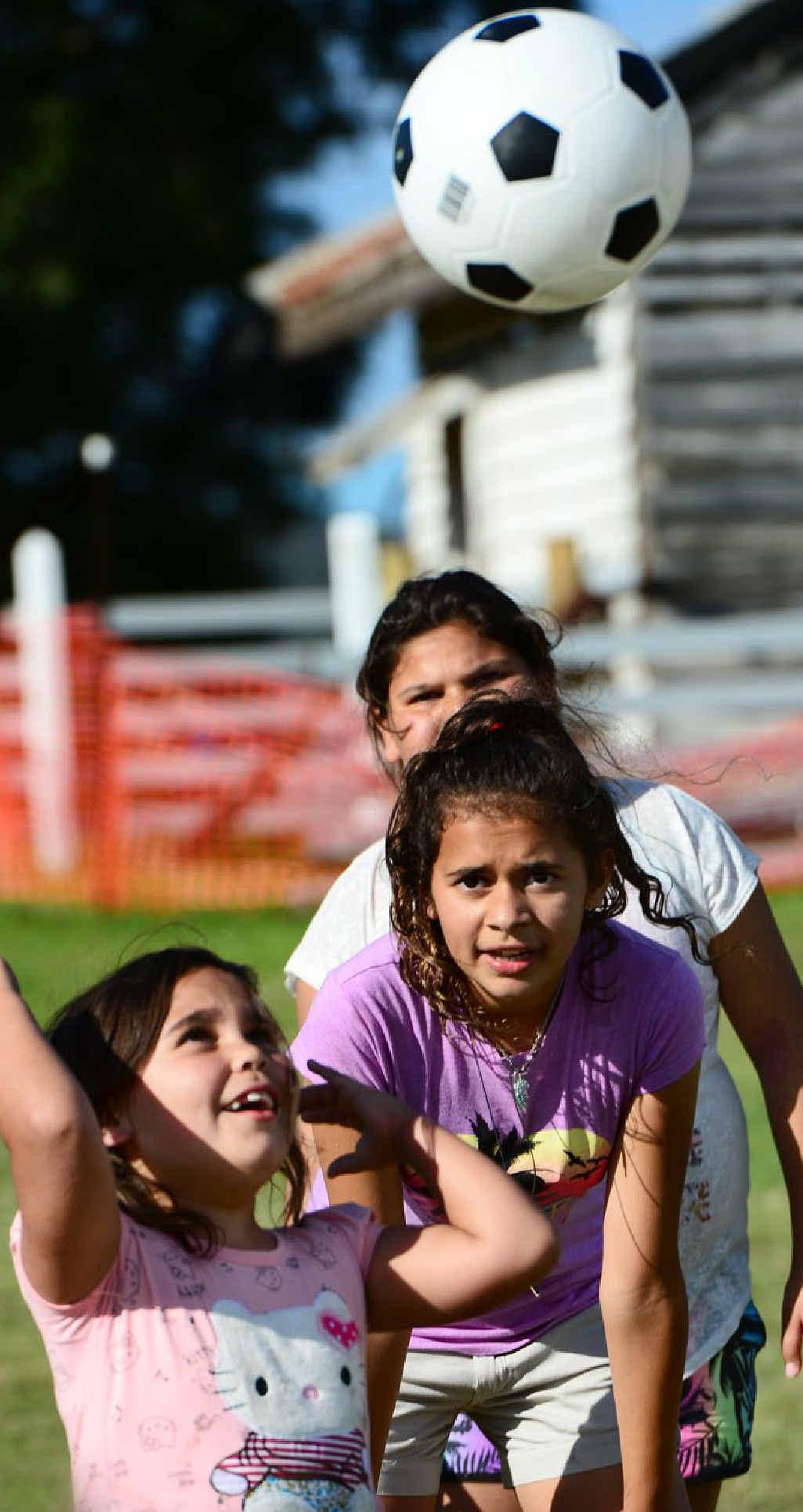 PLAY BALL: Lyreisha Thompson (left), 8, and Nahkari Carr-Smith, 11, participate in a camp at the Purga Elders and Descendants Aboriginal Corp.