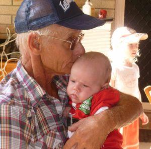 Kevin Neilsen shares a kiss with his grandchild, Corey Neilsen.