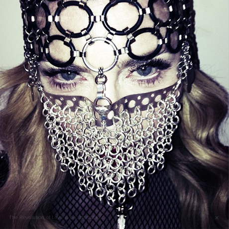 Madonna poses in a chainmail niqab for a photoshoot with US Harper's Bazaar.
