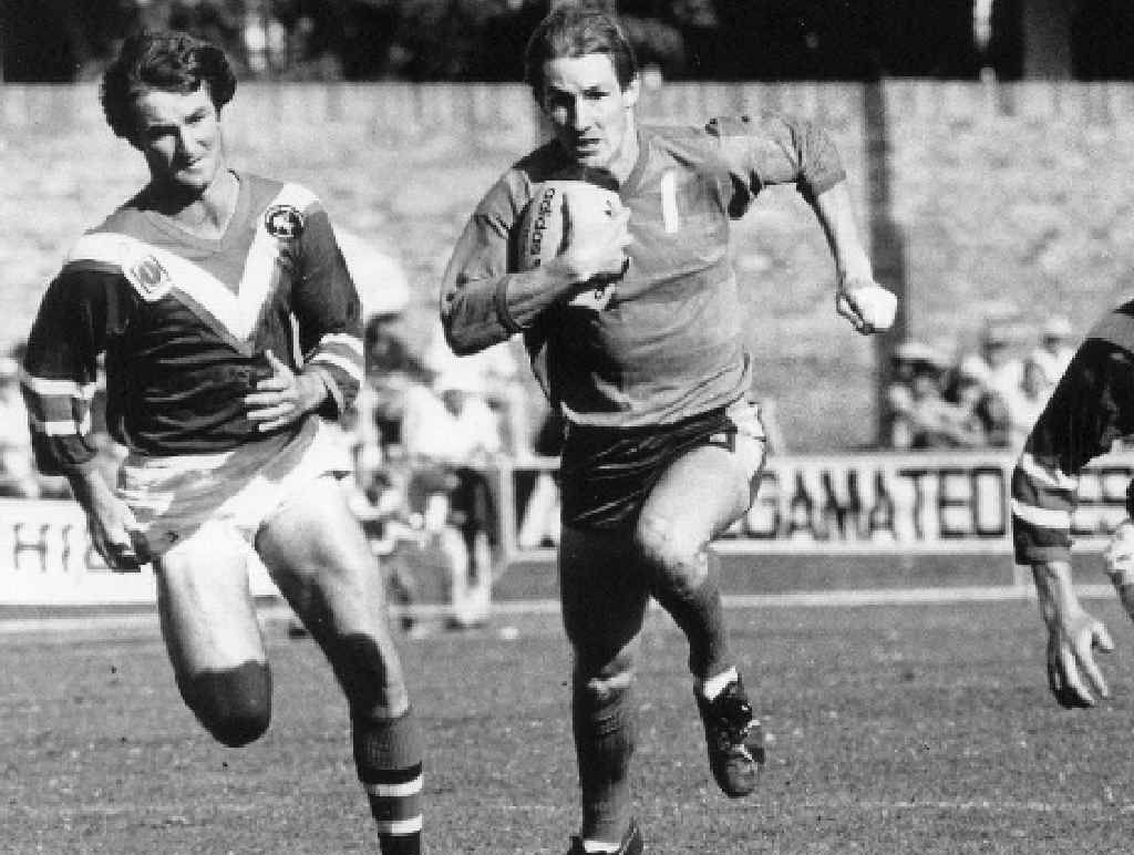 ON FIRE: Mal Eames (left) and Mark Browne (right) move in on an opposition player in the golden years of the Warwick Cowboys.