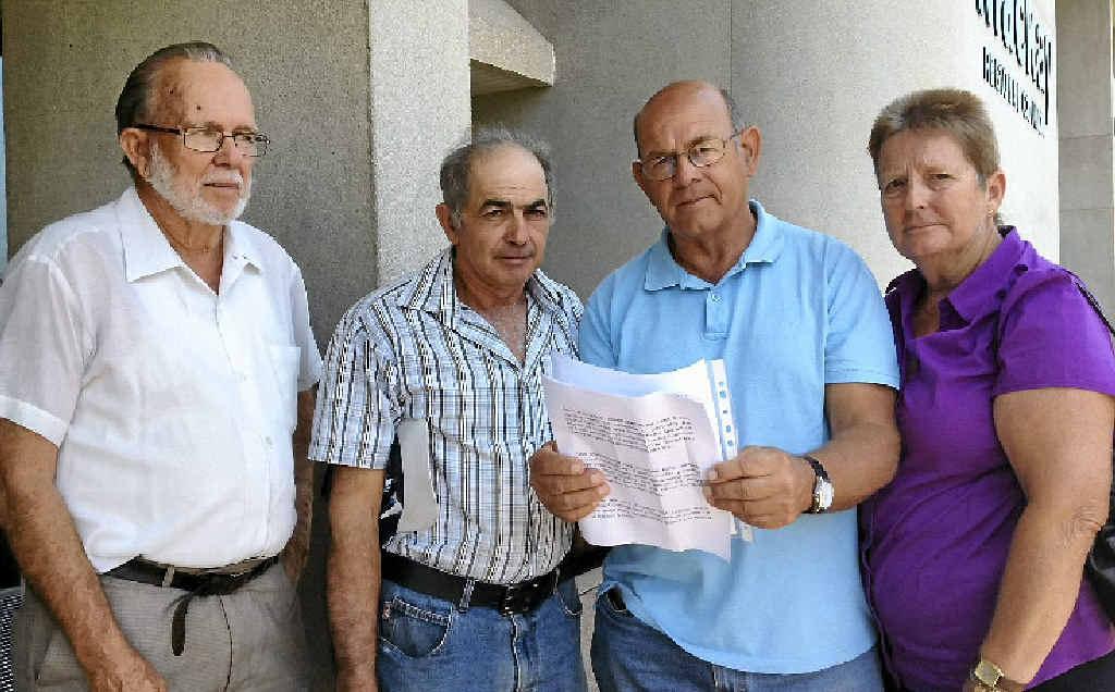 Ron Williams (left), George Zammit, Alan Leyshon and Lynda Leyshon with a 300-signature petition.