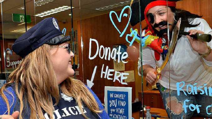 Bank of Queensland staff Dannika Pethebridge, left, and pirate Rebecca Galea enjoy getting in costume for charity.