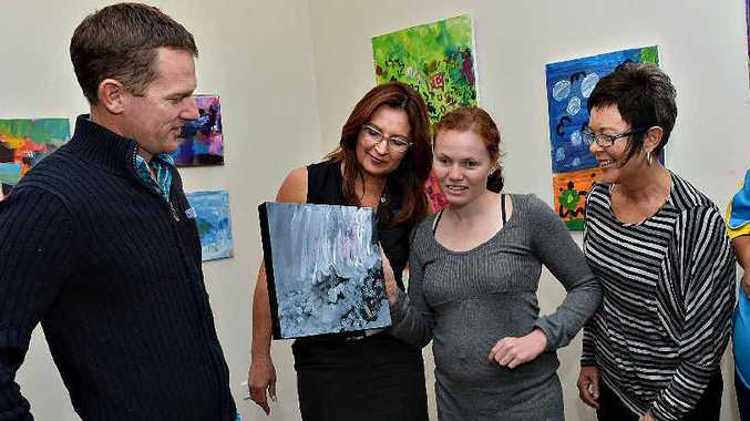 Admiring the art is Adrian Harris (left), Nicola Orchard, Sally Morley with her piece Flowers and Rain, and Kerry Ann Smith.