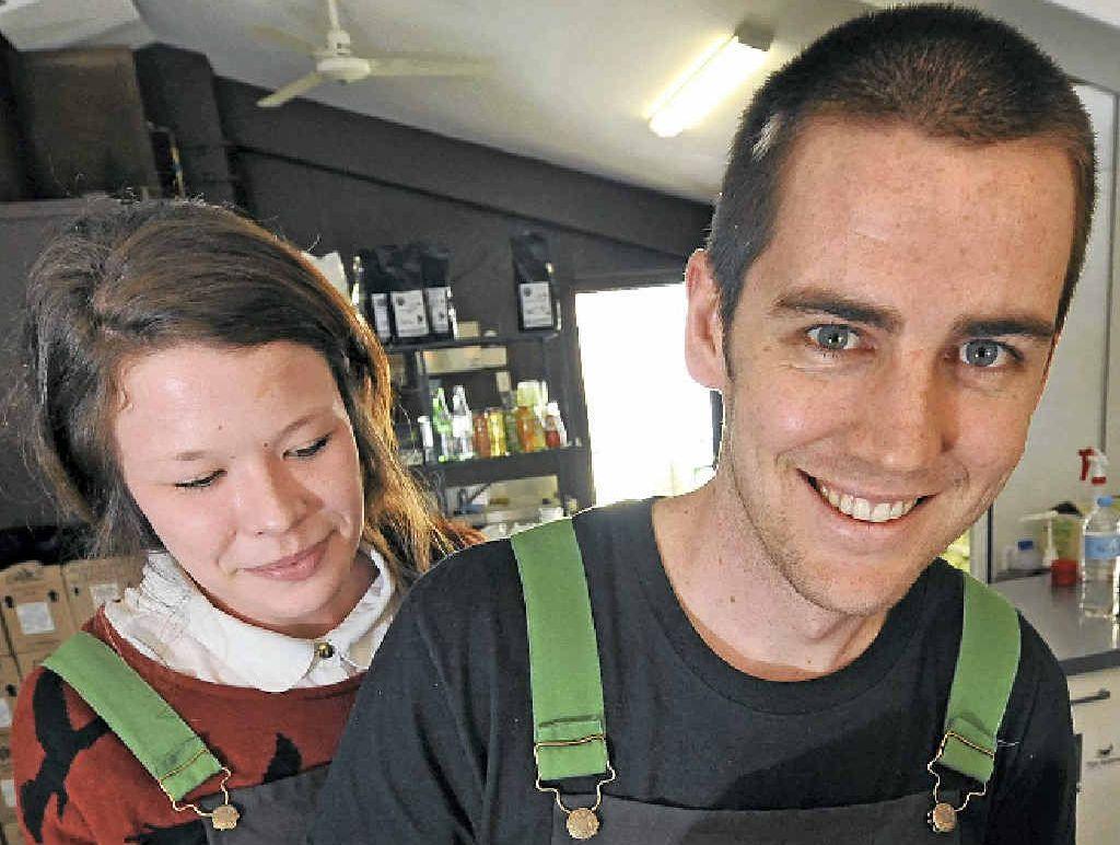 GOOD JAVA: Lamkin Lane Espresso Bar co-owner James Pedrazzini shows off his skills to Erin Martyn.