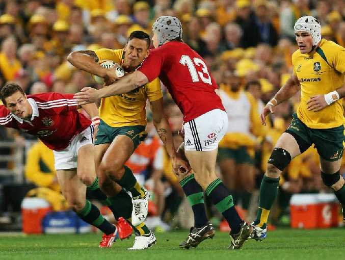 GOTCHA: The Wallabies' Israel Folau feels the pain as the Lions defence closes in last night.