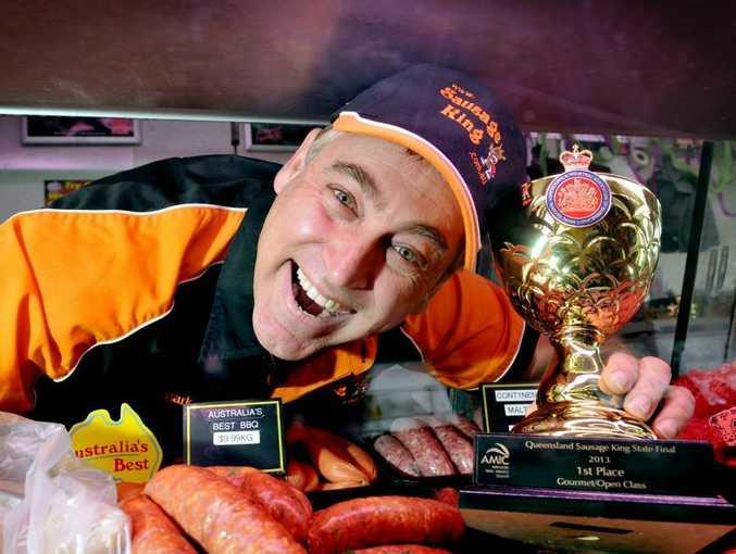 Mark Nolan shows off his prize winning bush tomato sausages.