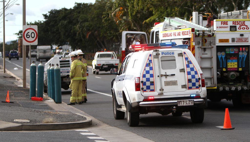 Emergency services with six Argoshield cylinders that fell from a truck on Gladstone Road. Photo Allan Reinikka / The Morning Bulletin