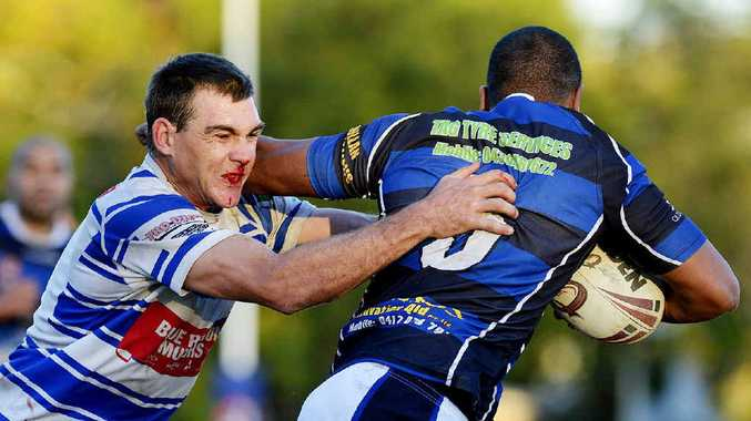 UP TEMPO: Brothers centre Troy Sharpe hauls in a Goodna player in his team's 34-18 win yesterday.