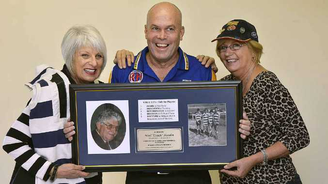 LASTING MEMORIES: Sisters Donna Beasley and Debra Briggs join Ipswich Eagles committee member Mick Whiteley to unveil the club's tribute to life member Noel Kimlin.