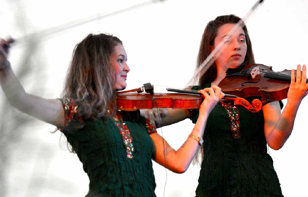 MUSICAL MAGIC: Two members of the quartet Quatro, Amity Brand on the violin, and Vanessa Smith on viola, perform a variety of pieces including Bohemian Rhapsody and Sweet Child of Mine at Mackay Sugar Classical in the Cane Fields at Greenmount Homestead.