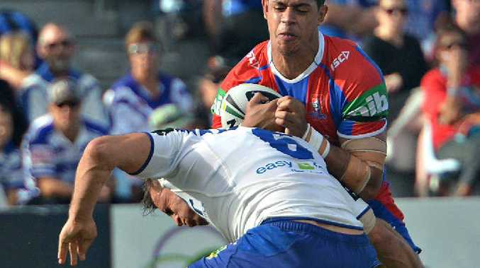 CAUGHT: Knights' Dane Gagai is tackled by Bulldogs' Josh Reynolds at Virgin Australia Stadium.