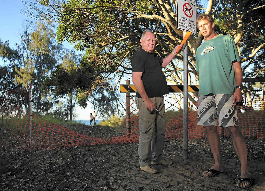 NOT HAPPY: Tannum Sands residents Hedley Platten and David Bealing at the closed access point to second beach.