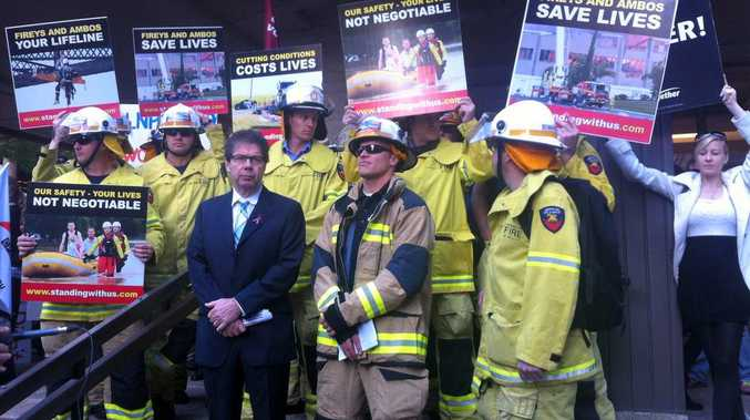 Queensland Council of Unions president John Battams and firefighters protesting against the Queensland MPs pay rise.