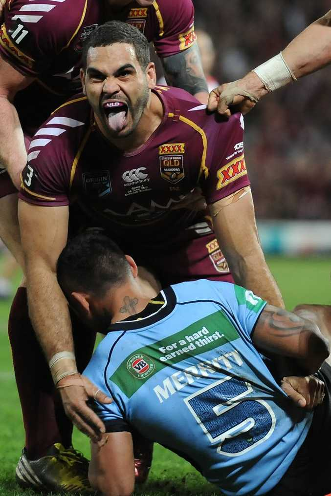 BRISBANE, AUSTRALIA - JUNE 26: Greg Inglis of the Maroons celebrates a try during game two of the ARL State of Origin series between the Queensland Maroons and the New South Wales Blues at Suncorp Stadium on June 26, 2013 in Brisbane, Australia. (Photo by Matt Roberts/Getty Images)