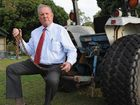 Doug Waters from Burrum Heads with the tractor he used to tow vehicles bogged in the national park.