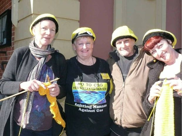 KNITTING NANNAS: Suzanne Golden of Ulmarra, Jenny Leunig of Goonellabah and Clare Twomey of North Lismore showing support for Alan Roberts (second from right) outside Maclean Court House ahead of his test case on charges arising from the Glenugie CSG protests. Photo: Tim Howard