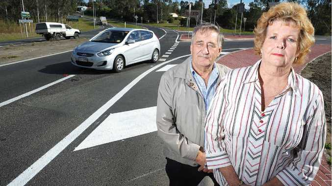 ANGRY: George Hatchman and Charmaine Harrold are furious with the changes made to the Cunningham Hwy intersection with Ipswich-Rosewood Rd. INSET: A car rollover at the corner of the Cunningham Hwy and Rosewood-Amberley Rd.